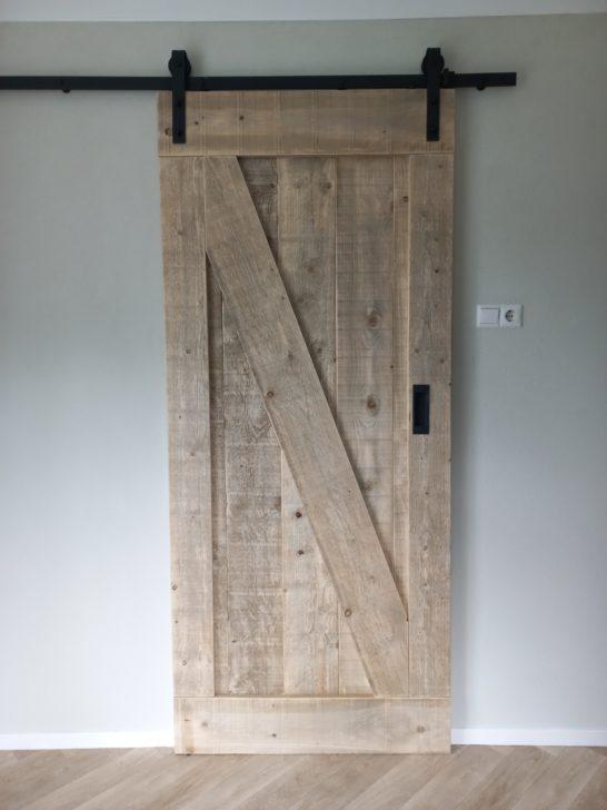Steigerhouten loft-/schuifdeur met industrieel ophangsysteem